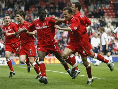 MIDDLESBROUGH - MAY 3:  Middlesbrough players celebrate Szilard Nemeth's goal during the FA Barclaycard Premiership match between Middlesbrough and Tottenham Hotspur at the Riverside Stadium on May 3, 2003 in Middlesbrough, England. (Photo Gary M Prior/ Getty Images)