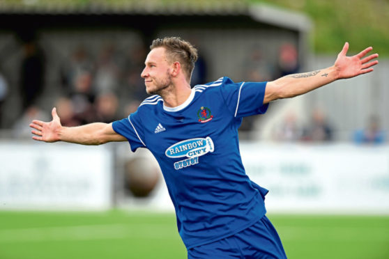Highland League ;  Cove Rangers (blue) vs Fraserburgh (black/white)  Pictured - Cove's Mitch Megginson celebrates his second goal.  Picture by Kami Thomson    04-08-18